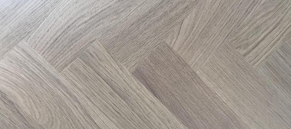 Houten vloer op vloerverwarming met warmtepomp